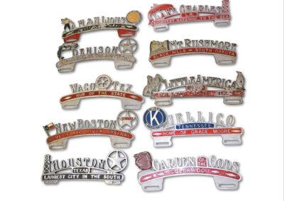 Ten Cast Aluminum License Plate Attachments - $ 300-$ 500