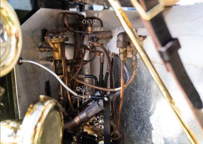1908 Stanley Model M Five-Passenger Touring apercu de la tuyauterie - Hershey Auction.
