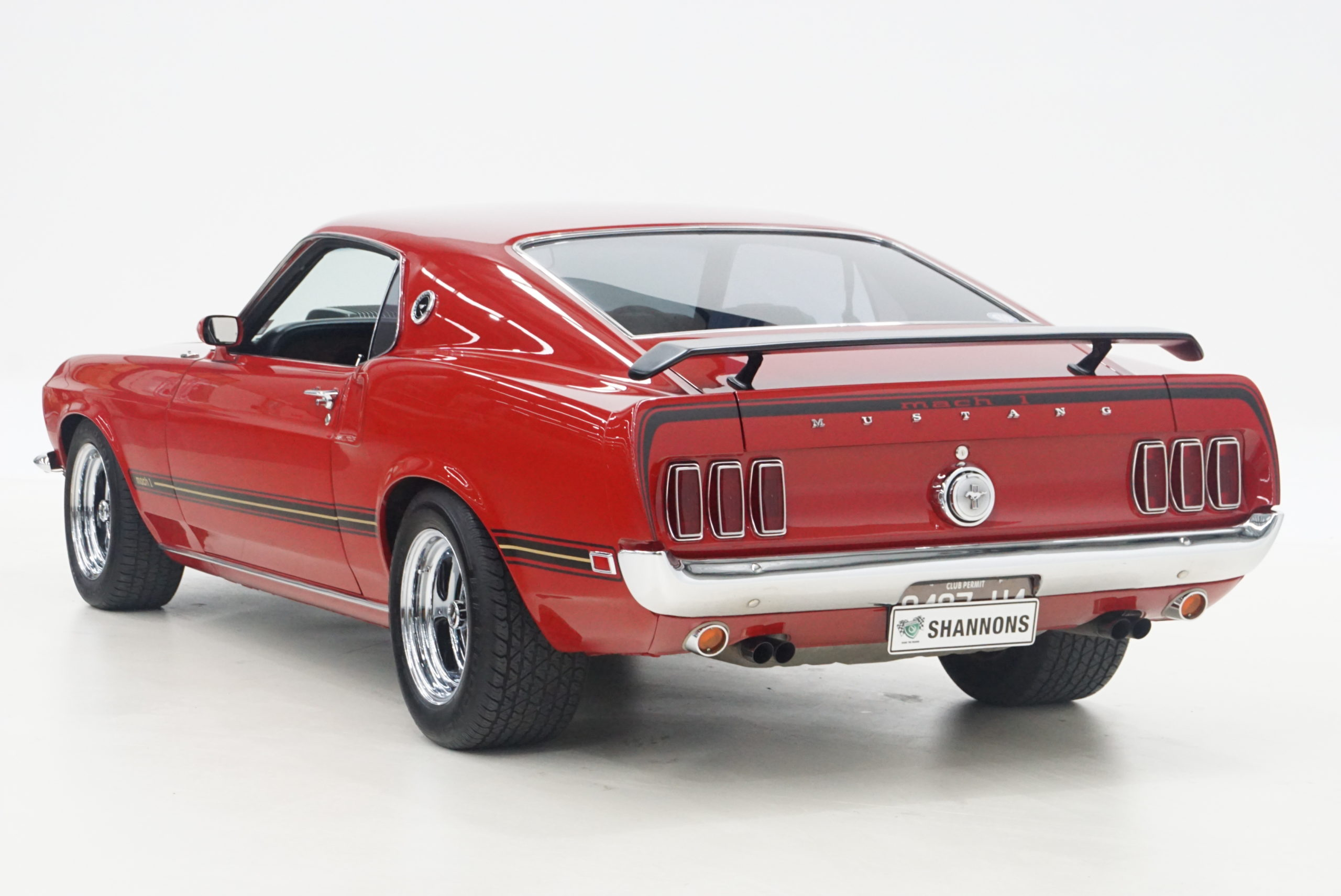 1969 Ford Mustang Mach 1 Fastback trois quarts arrière gauche - Shannons Auctions avril 2021.